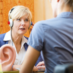 Woman talking to audiologist at fitting