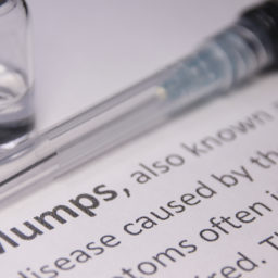 Mumps Definition with Vaccine Needle and Vial