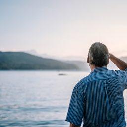 Man stares out at lake